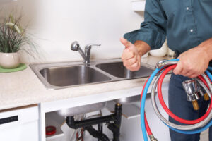 A person washing a sink Description automatically generated with low confidence